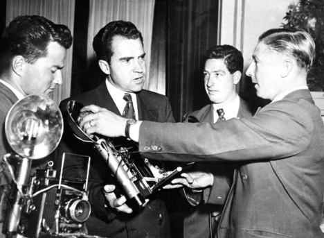 Here is Ern showing his heavy equipment to Richard Nixon,